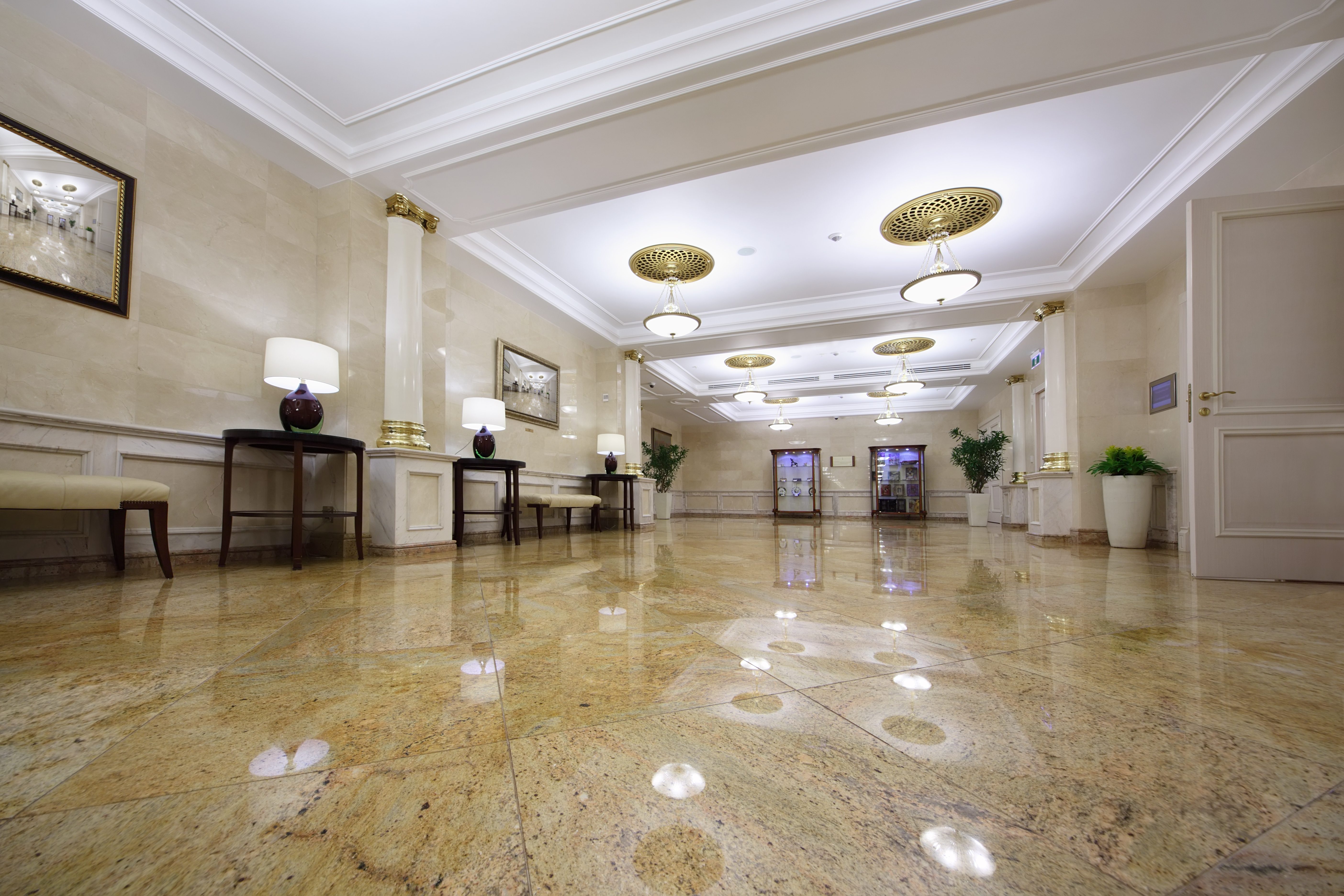 Granite and quartz can transform the look of your business for Granite flooring